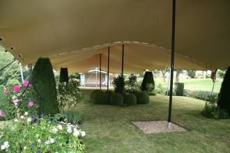 Wedding Ceremony Tent, Rigged over delicate rose garden, Oxford